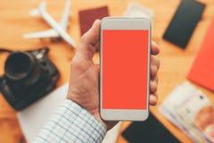 App del viaje de negocios para la mofa del teléfono móvil encima de la pantalla imagen de archivo