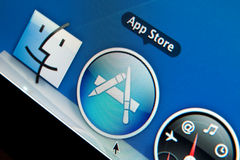 App Store. Icon in dock on Apple computer LCD: e-commerce royalty free stock photography