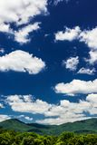 Beautiful Blue Sky and Green Mountains stock photo