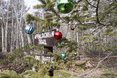 Appalachian trail sign and tree. Signage along Appalachian Trail in Pennsylvania next to tree decorated with Christmas ornaments Stock Photography