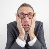 Appalled manager terrified by corporate announcement expressed with humor. Expressive corporate man concept - shocked middle age businessman expressing surprise royalty free stock image
