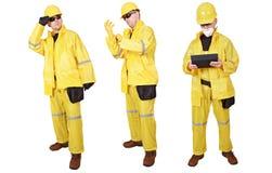 Appaltatori gialli del vestito immagini stock