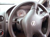 Apparater ett hjul och en speedometer arkivfoton