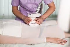 Apparaturcosmetology för en kroppmassage Royaltyfri Foto