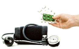 Apparatus for measuring blood pressure and different pills in ha Stock Image