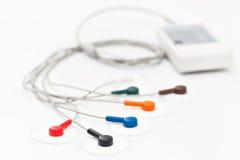 Appareil ou dispositif portatif mobile l'unité de la mesure de l'électrocardiogramme dans un bureau du ` s de docteur Photographie stock