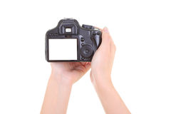 Appareil-photo de Dslr dans des mains femelles. copyspace Image libre de droits