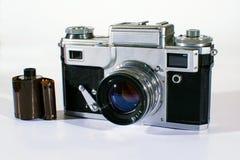 Appareil-photo de vintage avec le film Photographie stock
