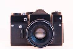 Appareil-photo de vintage sur le fond blanc d'isolement Photo stock