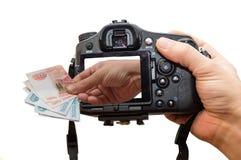 Appareil-photo et argent Photographie stock