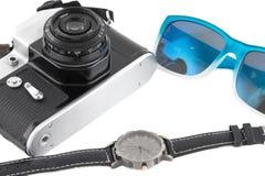 Appareil-photo, lunettes de soleil et montre-bracelet image libre de droits