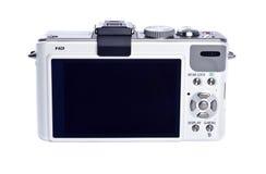 Appareil photo numérique de point et de pousse d'isolement sur le blanc photo stock