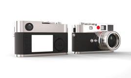 Appareil photo numérique de style de vintage - avant et dos photographie stock libre de droits