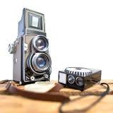 Appareil-photo réflexe de vieille jumeau-lentille avec le mètre léger Photographie stock