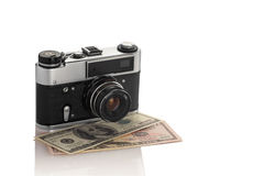 Appareil-photo sur dollars2 Photo stock