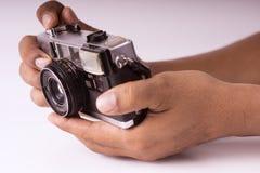 Appareil-photo tenu dans la main Image stock
