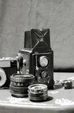 Appareils-photo et lentille de cru Image stock