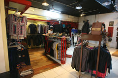 Apparel. Buyers choose apparel in store in the town of Solo, Central Java, indonesia Royalty Free Stock Photography
