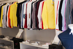 Apparel store with men shirts. On hangers Stock Images