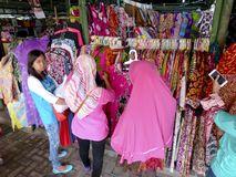 Apparel. Traders sell apparel at a souvenir market in the city of Solo, Central Java, Indonesia Royalty Free Stock Image