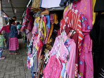 Apparel. Traders sell apparel at a souvenir market in the city of Solo, Central Java, Indonesia Stock Images