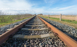 Apparently endless rusty train rails Royalty Free Stock Images