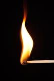 Appariez l'éclatement dans la flamme Image stock
