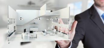 Appartamento commovente della rappresentazione di bianco 3D dell'uomo d'affari con il suo finge Fotografie Stock Libere da Diritti