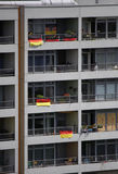 Appartement buildings. CIRCA JUNE 2014 - BERLIN: appartement buildings in the multinational Kreuzberg district of Berlin with national flags during the football Stock Photo