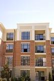 Appartements de brique et de stuc Photo stock