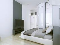 Appartements trois-étoiles élégants d'hôtel dans le blanc Images stock