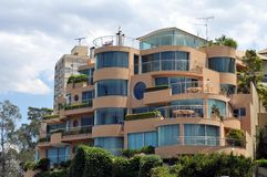 Apartment building at seafront in Darling Harbour Royalty Free Stock Image