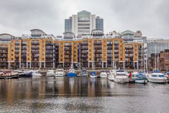 St. Katharine Docks, Tower Hamlets, London. Appartments and marina of St. Katharine Docks in the London Borough of Tower Hamlets. United Kingdom royalty free stock photos