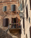 Appartments in Siena with blinds and washing Stock Photography