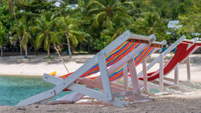 Appealing Beach Chairs on Sand. Palm Trees and Ocean in Background. Haad Salat. Koh Pangang, Thailand.  Royalty Free Stock Photo