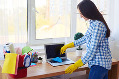 Appealing lady dusting with small broom keyboard Royalty Free Stock Image