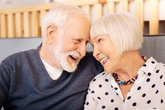 Appealing senior couple expressing love stock photography