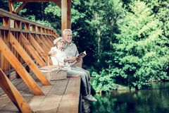 Appealing spouses having a good time while reading together royalty free stock photo