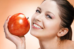 Appealing woman with apple Stock Image