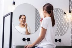 Free Appealing Woman Brushing Teeth In Front Of Circular Mirror Royalty Free Stock Photos - 143339278