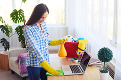 Appealing woman cleaning with mop and splash laptop Stock Photos