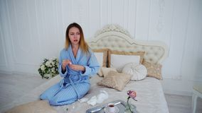 Women Caught Cold and Treated With Medication and Sitting on Large Bed in. Appealing Woman Unwell, Suffering From Cold and in Pharmacy Herb Spray to Improve Stock Photography