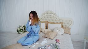 Women Caught Cold and Treated With Medication and Sitting on Large Bed in. Appealing Woman Unwell, Suffering From Cold and in Pharmacy Herb Spray to Improve Stock Photos