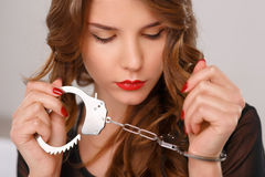 Appealing young girl posing with handcuffs Stock Photography