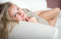 Appealing young woman on a sofa Stock Photos