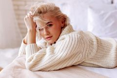 Free Appealing Young Woman With Wavy Hair Wearing Beige Sweater Stock Photos - 143516943