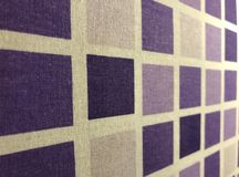 Appearance of plaid textile surface with purple squares. Appearance of plaid textile surface. Cotton fabric product . Dark and light purple squares on white stock images