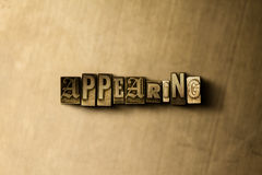 APPEARING - close-up of grungy vintage typeset word on metal backdrop. Royalty free stock illustration.  Can be used for online banner ads and direct mail Royalty Free Stock Image