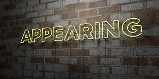 APPEARING - Glowing Neon Sign on stonework wall - 3D rendered royalty free stock illustration. Can be used for online banner ads and direct mailers Royalty Free Stock Photo