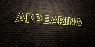 APPEARING -Realistic Neon Sign on Brick Wall background - 3D rendered royalty free stock image. Can be used for online banner ads and direct mailers Stock Images